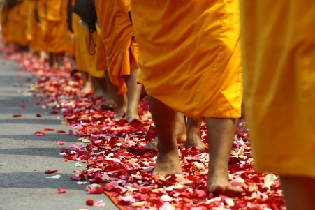 Buddhists walk on petals